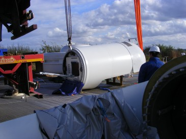 renewables first - lifting the nacelle onto the wind turbine tower sections