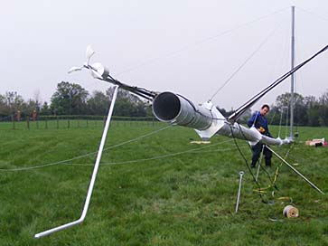 Wind resource assessments - A guyed wind monitoring mast being prepared on the ground by Renewables First