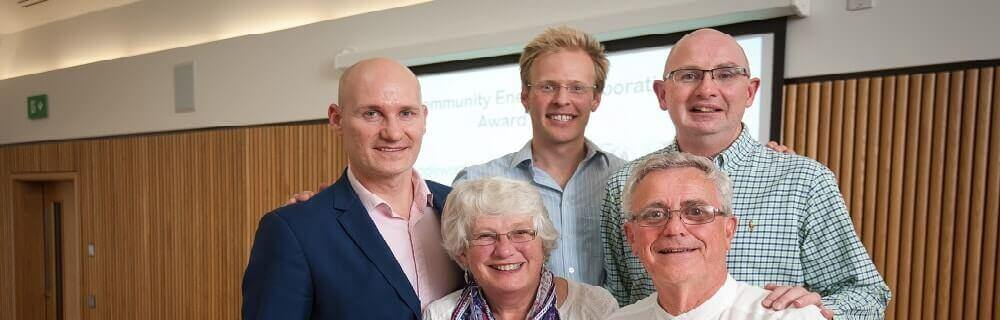 Oxford, UK. 5th September 2015. The second annual Community Energy Awards held at the Said Business School. L-R: Jonathan Hazeldine (Marks and Spencer) presents the award to Alison Brittle, Bill Edwards (both front row) and team (behind) of Saddleworth Community Hydro. Photo: Andrew Walmsley