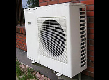 Typical air-source heat pump on a domestic house; they look similar to air conditioning units